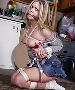Roped, gagged with her pantyhose, exposed