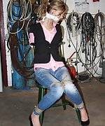 Irena cleave-gagged struggling to get out of her chair