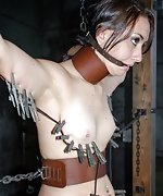Cutie cuffed and gagged with leather restraints