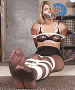 Girl gets roped, tape-gagged and hogtied