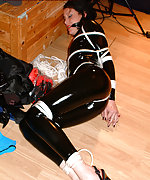 Shiny black latex and rope bondage