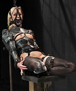 Latex blond gets strapped, clamped, teased and trained
