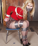 Blond gets roped, tape bound, tape gagged, hogtied