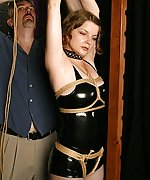 An unforgiving black rubber suit and ropes