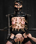 Mercilessly tormented in latex, harsh chain bondage