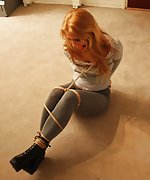 Cutie roped on the floor and ball-gagged