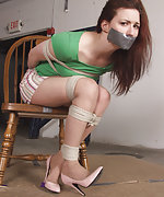 Courtney gets roped and tape-gagged