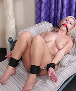 Sexy blond milf bound and gagged on her couch