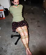 Brunette cutie roped on a chair, ball-gagged, tit-grabbed